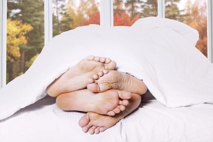 http://www.dreamstime.com/royalty-free-stock-photos-close-up-couple-feet-bed-two-sleeping-autumn-background-window-image44501568